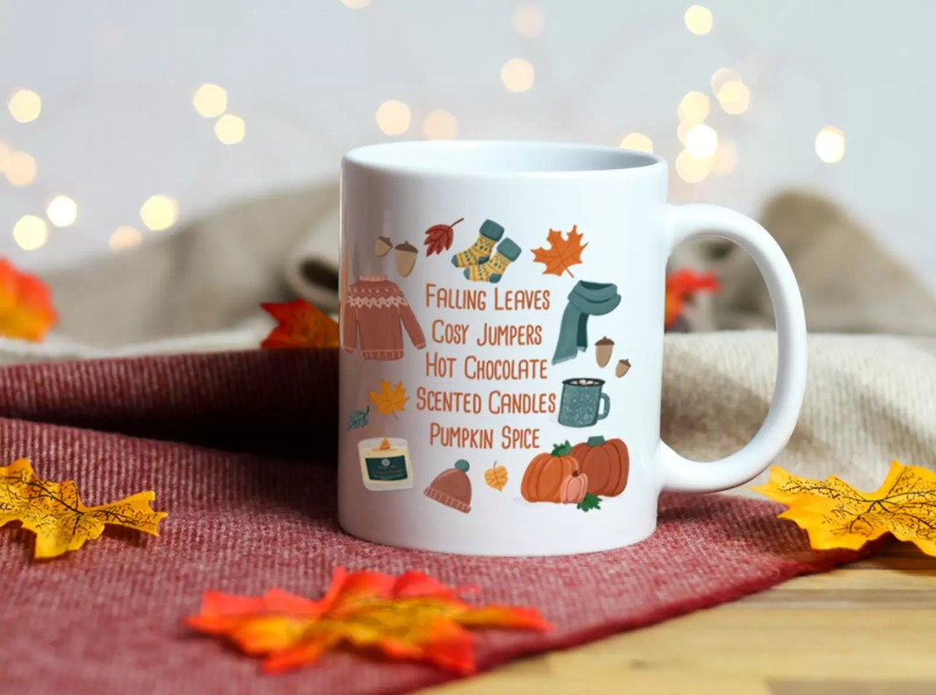 white ceramic mug with the words falling leave, cosy jumpes, hot chocolate and more autumn inspired things