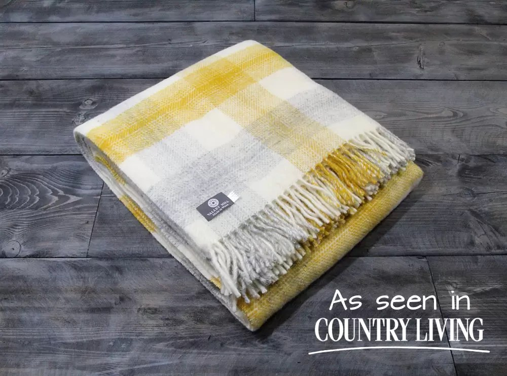 Valley Mill blankets are made in North Wales and this one has a yellow and grey meadow check colour