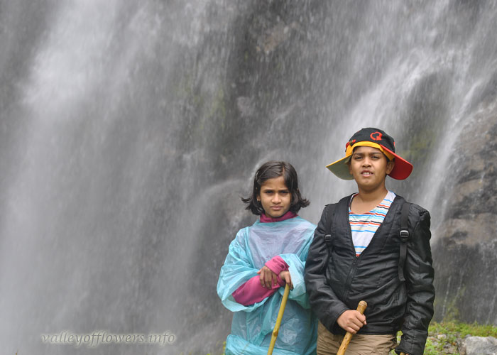 Me and My Brother near a waterfall on the entrance to Valley of Flowers
