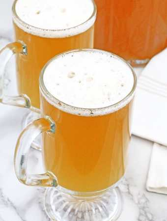 """This traditional Ukrainian Apple Kvass - Квас """"Яблочный""""drink is truly yummylitious! There are many different kvass recipes, including the most popular bread kvass, but this recipe has a delicious, apple flavor that is just delightful and enjoyed by adults and kids alike. Kvass is a perfect thirst-quenching drink, remarkably refreshing, especially during these hot summer days."""