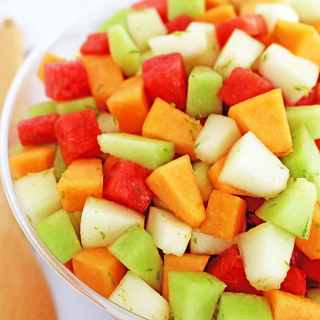 Melon Fruit Salad with Honey Lime and Watermelon Juice Dressing