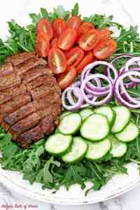 This Arugula Steak Salad with Balsamic Vinaigrette Dressing is very colorful, light, crunchy, flavorful, refreshing and satisfying, it is sure to impress! If your New Year's resolution is to eat healthily or whether you want to detox your body I would recommend adding this superfood - ARUGULA to your diet. While most green vegetables are considered healthy and nutritious, arugula does stand out among the rest of the greens do to very low in calorie but high in calcium, iron and other nutrients.