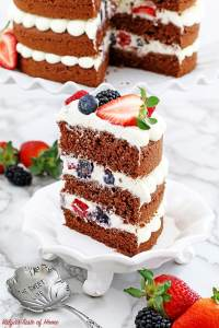 This Red Velvet Berry Cake recipe is super moist, pillow soft and is made with natural red beet juice instead of the typical store-bought red food dye. The naked cake layers are piped with an absolutely creamy and smooth cream cheese frosting and heavily loaded with delicious berries. The cake looks absolutely stunning! Perfect for parties, anniversaries, or just simply enjoy a slice or two for a tea with a friend. The berry addition in this cake not only adds eye-grabbing beauty but makes it just a bit healthier as well, right?