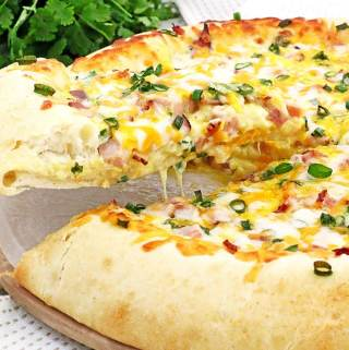 Nothing beats the taste of Bacon, Egg, and Ham Breakfast Pizza Recipe made from scratch! Soft homemade pizza dough topped with your favorite breakfast ingredients make it taste irresistible! You will be looking forward to waking up early knowing what's on the menu for tomorrow, so you can enjoy the scrumptious slice of the cheese breakfast pizza.