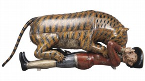 'Tipu's Tiger', a carved and lacquered wooden semi-automaton in the shape of a tiger mauling a man, Mysore, India, about 1793. Museum no 2545 (IS).