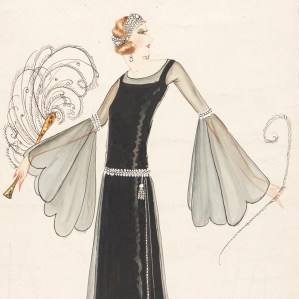 Normal Hartnell London, 1920s. The under dress is of solid material and is covered from shoulder to hem with chiffon. The dress has a boat neck line with tight sleeves up to the elbow where they fan out with 'scollop' edging. This matches the hem of the dress.