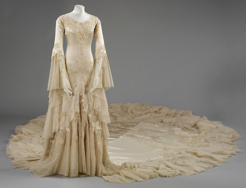 Silk satin wedding dress, designed by Norman Hartnell, 1933, given and worn by Margaret, Duchess of Argyll. © Victoria and Albert Museum, London