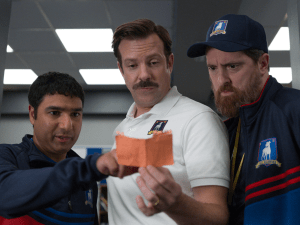 "AFC Richmond's three ""coaches"" in Ted Lasso (from left to right Nick Mohammed as Nathan, Jason Sudeikis as Ted, and Brandon Hunt as Coach Beard)"