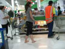 Women Barefoot at Grocery Store