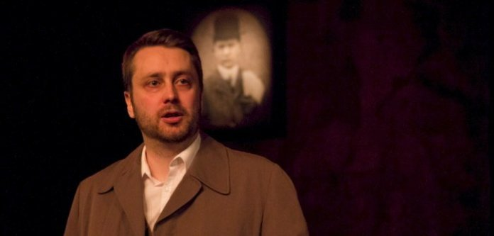 Rob Drummond performs in Bullet Catch. Photo by Megan Verhey.