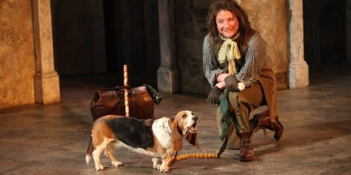 Andrew Cownden as Launce and Gertie the Basset hound as Crab in the Bard on the Beach production of The Two Gentlemen of Verona. Photo by David Blue.