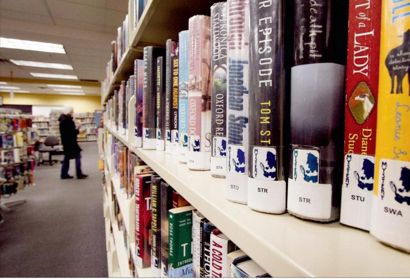 Books line the shelves at the Oak Bay branch of the Greater Victoria Public Library.