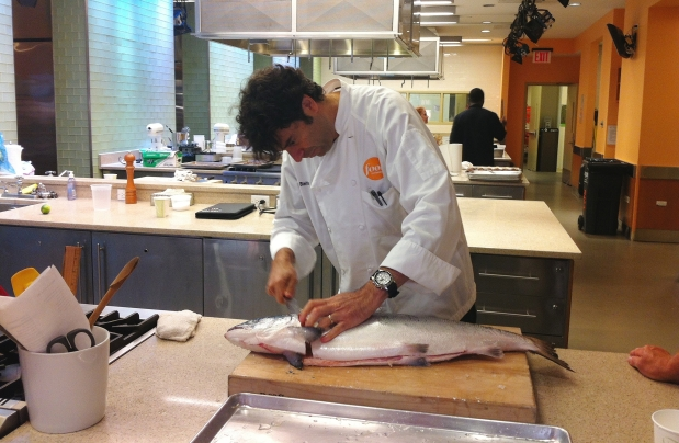 Food Network chef filleting his first Skuna Bay Salmon.