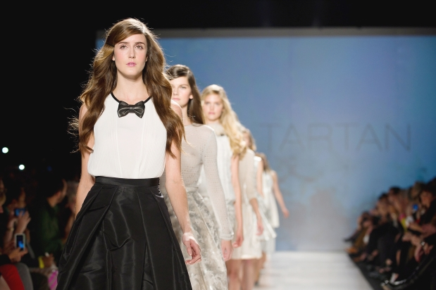 A models walks the runway to end the Pink Tartan show during opening night of Toronto Fashion Week on Monday October 22, 2012.