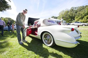 Photo by Marisol Diaz Owner William Schieck of Bayside, show a peak into the exterior of his Polo white 1954 Chevrolet Corvette, 6 cylinder, fiberglass body and white wall tires on view at the Jaguar show held the Vanderbilt Museum in Centerport, Sept. 14, 2014.