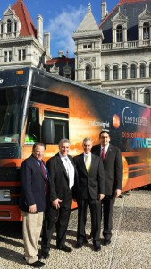 At the State Capitol in Albany: Assemblyman Andrew Raia, Bob Keller of National Grid Foundation, Lance Reinheimer of Vanderbilt Museum, and Assemblyman Chad Lupinacci.
