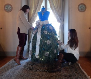 Mary Schlotter (left) and Khristia McCord of Harbor Homestead & Co. in Centerport create a Christmas dress for Rosamund Vanderbilt in her dressing room