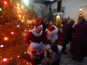 Mr. and Mrs. Claus give treats to children at the Tree Lighting Vanderbilt Museum photo