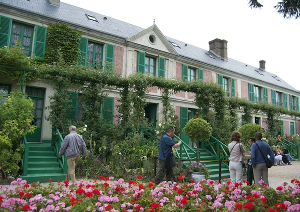 Monet's house fronted with colourful geranium beds