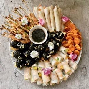Asian Lovers Canapes including satay, duck crepes, rice paper rolls, fish cakes and squid in ink slider buns