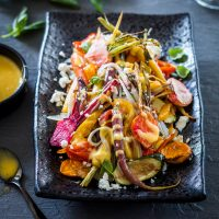 Roasted Vegetable Salad with garlic aioli drizzle