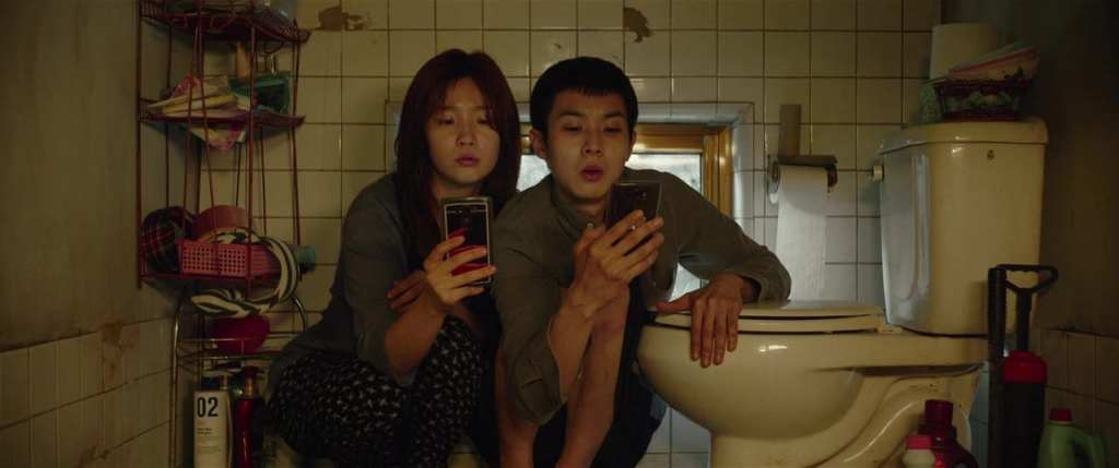 Woo-sik Choi and So-dam Park in Parasite