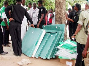 File photo: Police guard some INEC's voting material during election.