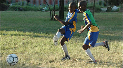 Kids in action at a football match.