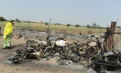 Ruined motorcycles at local drinking joint in Dalla Maiduguri, where a bomb was detonated sunday evening. NAN photo