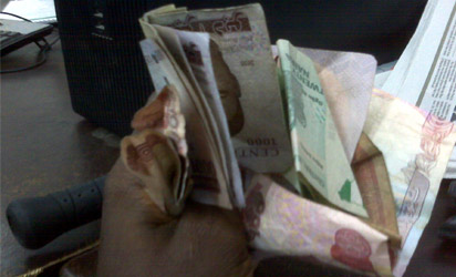 Image result for lagos woman counting cash inside the bus