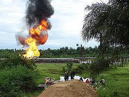 Oil fire, victims