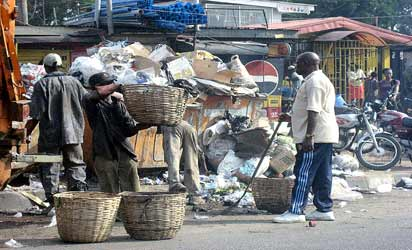 *Refuse collectors at a collection point