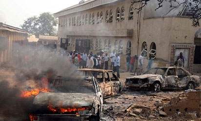 File Photo: A car burns at the scene of a bomb explosion at St. Theresa Catholic Church at Madalla, Suleja, on December 25, 2011.