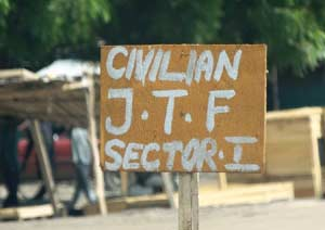 A sign near a checkpoint of a vigilante group reads Civilian J.T.F or Civilian Joint Task Force  in Maiduguri,. Young men and women have in recent weeks formed vigilante groups, hunting down Boko Haram Islamists who have sneaked back into the city following a military offensive on their camps on the Nigerian border with Niger, Chad and Cameroon with remarkable success. AFP PHOTO