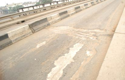 The dilapidated portion on the Dopemu-Akowonjo link Bridge. Photo: Kehinde Gbadamosi