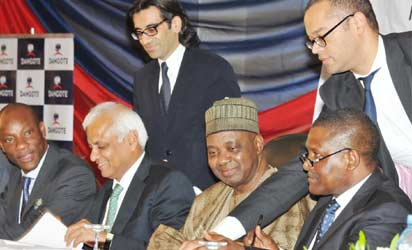 $9bn refinery: —From left: Chief Executive Officer, GTB, Segun Agbaje; Chief Executive Officer, Standard Chartered Bank, London, Anil Dua; Vice President Namadi Sambo and President, Dangote Group, Aliko Dangote during agreement signing ceremony of US$3.3 billion facility for Dangote's $9bn Refinery /Petrochemical /Fertilizer Complex at Oklng  Free Zone in Abuja,yesterdday.
