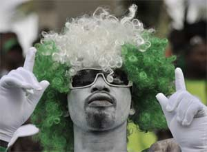 A Nigerian supporter attends the 2014 African Nations Championship (CHAN) qualifying football match between Ivory Coast and Nigeria on July 27, 2013 at the Robert-Champroux Stadium in Abidjan. Ivory Coast defeated Nigeria 2 - 0.  AFP PHOTO