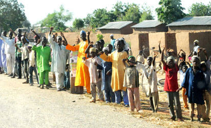 People waving at Gov.Isa Yuguda of Bauch State during official launch of 83km Alkaleri-Futuk road in Alkaleri Lga of Bauchi State recently.