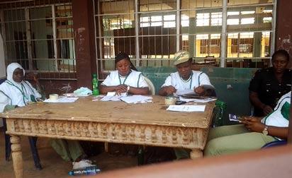 Electoral Officers waiting for voters at Akpakaogwe polling booth, Ogidi Ward 1 in Idemili LGA. Photo Tony Edike