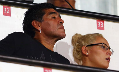 ALL FOR EAGLETS — Diego Armando Maradona looks on during the FIFA U-17 World Cup UAE 2013 Semi Final match between Sweden and Nigeria at Al Rashid Stadium yesterday.