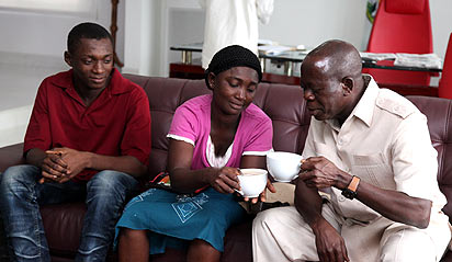 *Oshiomhole and the widow, Mrs Ifijeh drinking tea yesterday.