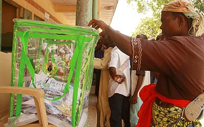 File: Voter casting her vote