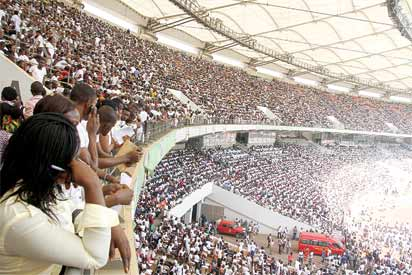 *Pix. 4: Applicvants who could not find seats await further insatructions as others take seats to write the Nigeria Immigration Service examinations at the 60,000 capacity National Stadium, Abuja. Photo by Abayomi Adeshida