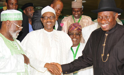 President Goodluck Jonathan (R) In A Handshake with APC Chieftain, Gen.Muhammadu Buhari, at the All-Political Parties  Summit in Abuja on Thursday (12/6/14). with them are, former Head  of State, Gen. Abdulsalami Abubakar (L) and former Governor Of  Ogun, Chief Segun Osoba.