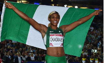 Nigeria's Blessing Okagbare celebrates winning the women's 100m athletics event at Hampden Park during the 2014 Commonwealth Games in Glasgow, Scotland on July 28, 2014.   AFP PHOTO