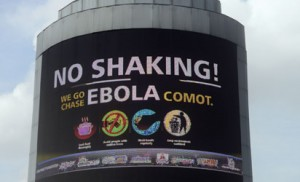 """A picture taken in Oshodi Heritage park in Lagos on October 20, 2014 shows an electronic information board on Ebola reading in pidgin English """"No Shaking ! We go Chase Ebola Comot"""" which means """"No cause for worry, we will chase Ebola away"""".  Africa's most populous nation Nigeria was on Monday declared officially Ebola free but warned that it remained vulnerable as long as the virus was raging elsewhere in west Africa. The country representative of the World Health Organization, Rui Gama Vaz, said 42 days -- or two incubation periods of 21 days -- had elapsed without any new confirmed cases of the deadly virus. AFP PHOTO"""