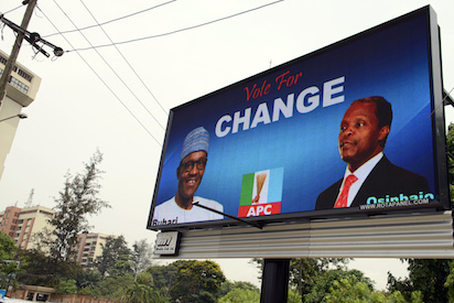 A picture shows an electronic billboard displaying a campaign poster of leading opposition All Progressives Congress (APC) presidential candidate Mohammadu Buhari and his running mate Yemi Osinbajo  in the Ikoyi district of Lagos, on February 24, 2015. Nigeria's President goodluck Jonathan is seeking re-election in the forthcoming presidential election which originally was scheduled for February 14 but rescheduled for March 28 due to security issues and a multi-national military operation against Boko Haram. AFP PHOTO