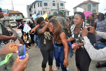 A Female APC Supporter allegedly beaten up at the Polls on Saturday in Rivers State when A Mamoth Delegation of Women led by the Rivers State Commissioner for Women Affairs Joe-eba West  tried to access the INEC Headquaters in Rivers State to Lodge their Complaints Over the Presidential and National Assembly Elections in the State. Photo: Nwankpa Chijioke
