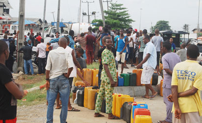 Long queue of jerry cans at a petrol station as fuel scarcity bites harder, yesterday.