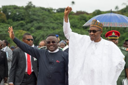 President Buhari cheering the crowd with Governor of Calabar Prof. Ben Ayade and Governor of Imo State Rochas Okorocha during the Ground Breaking Ceremony of 260Km Super Highway Double Carrier Road from Calabar to Northern Nigeria on 20th Oct 2015.
